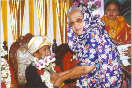 Mrs M.K. Halimaummal with her grand son Inayath